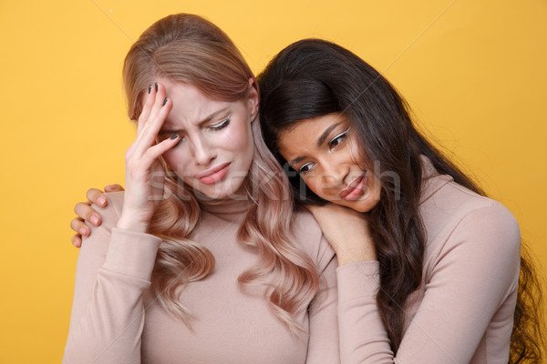 African lady calms sad caucasian lady friend Stock photo © deandrobot