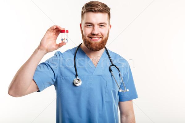 Zdjęcia stock: Lekarza · butelki · pigułki · leczenie · portret