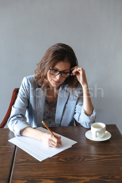 濃縮された 女性 書く ノート カップ ストックフォト © deandrobot