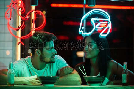 Multiethnic cheerful loving couple sitting in cafe Stock photo © deandrobot
