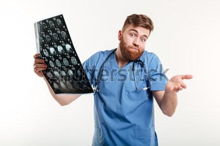 Töprengő férfi néz ventillátor ujj izolált Stock fotó © deandrobot