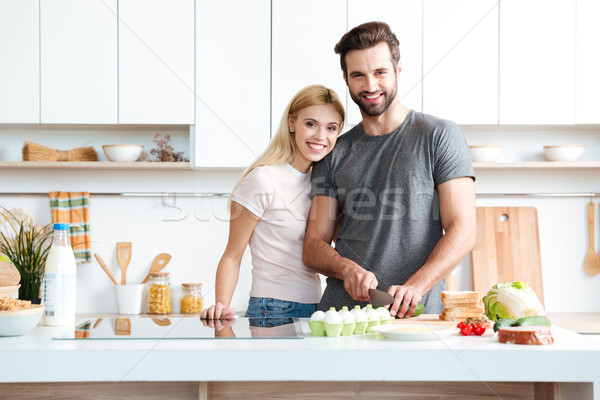 Married young couple enjoying their time at home Stock photo © deandrobot