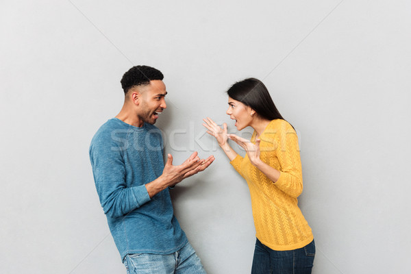 Young couple having a quarrel Stock photo © deandrobot