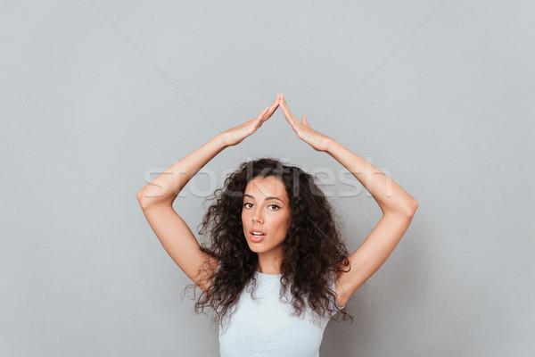 путать женщину сокрытие рук подобно домой Сток-фото © deandrobot