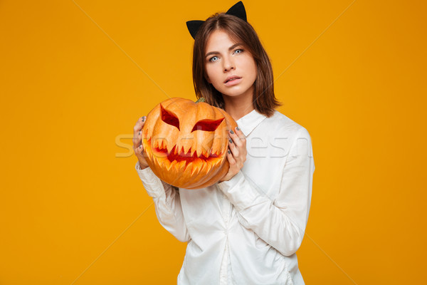 Komoly fiatal nő őrült macska halloween jelmez Stock fotó © deandrobot