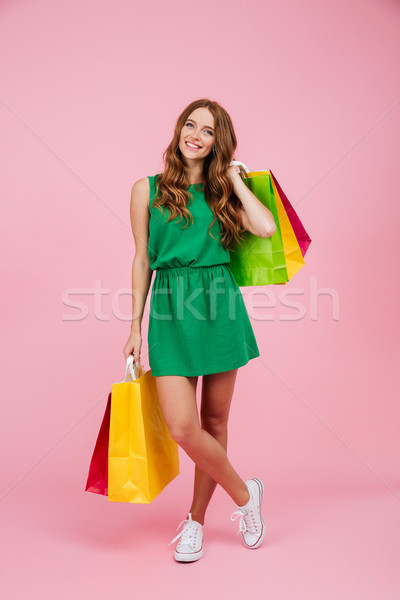 Full length portrait of young beautiful readhead curly woman in  Stock photo © deandrobot