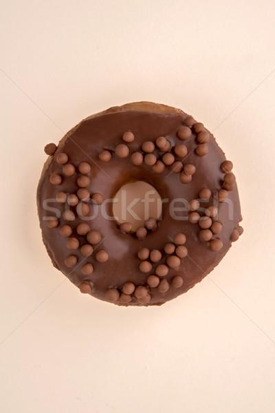 Egy fánk pelyhek izolált csokoládé fehér Stock fotó © deandrobot