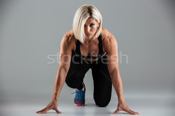 Portrait of a focused muscular fit sportswoman Stock photo © deandrobot