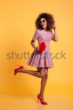 Stock photo: Full length portrait of a surprised cute afro american woman