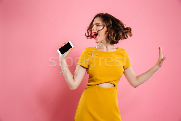 Portrait of a cheery woman in dress and make up Stock photo © deandrobot
