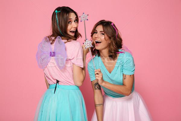 Dwa wesoły młodych dziewcząt jak skrzydełka Zdjęcia stock © deandrobot