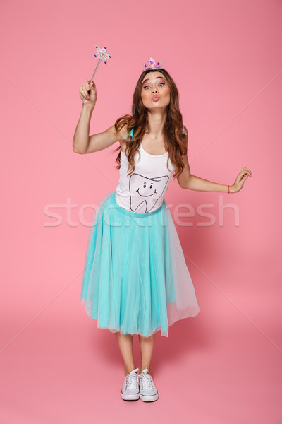 Full length portrait of beautiful birthday girl with magic wand  Stock photo © deandrobot