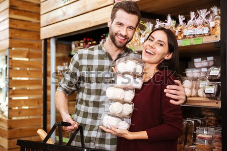 Stock photo: Smiling couple buying food for christmas
