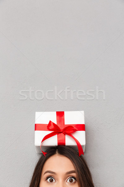 Funny image of cool woman bulging her eyes and posing with bithd Stock photo © deandrobot