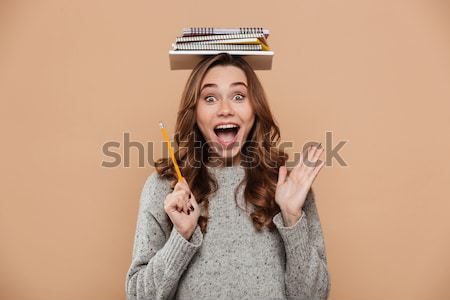 Close-up portrait of surprised female student in gray knitted sw Stock photo © deandrobot