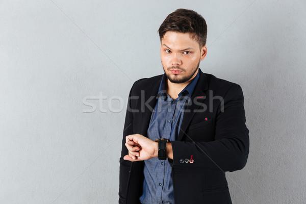 портрет серьезный бизнесмен время изолированный серый Сток-фото © deandrobot
