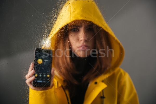 Közelkép zaklatott lány esőkabát fej áll Stock fotó © deandrobot