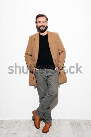 Full length portrait of a happy bearded man Stock photo © deandrobot