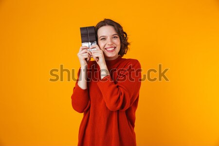 Amazing happy cute young pretty woman listening music with headphones singing in phone. Stock photo © deandrobot