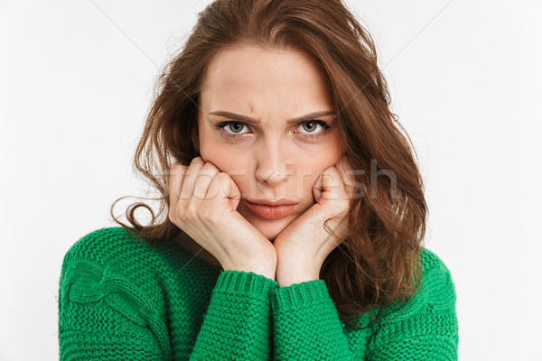 Close up portrait of an upset young woman Stock photo © deandrobot