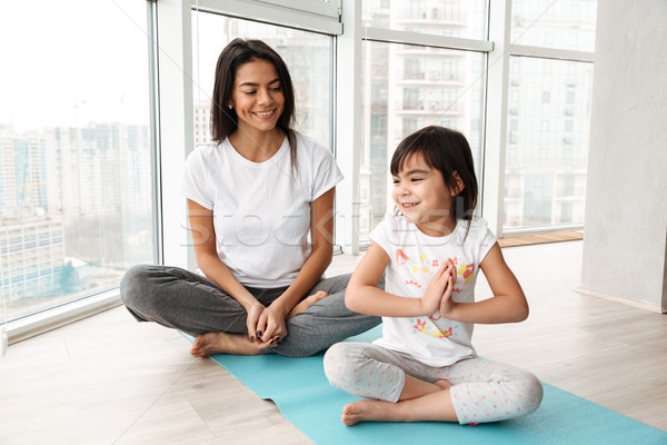 Boldog emberek nő kicsi gyerek gyakorol jóga Stock fotó © deandrobot