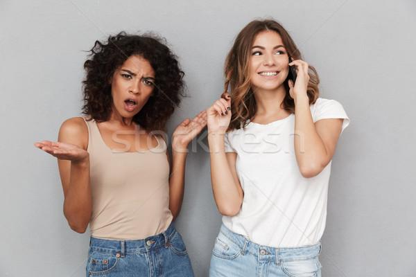 Retrato dos atractivo las mujeres jóvenes pie junto Foto stock © deandrobot