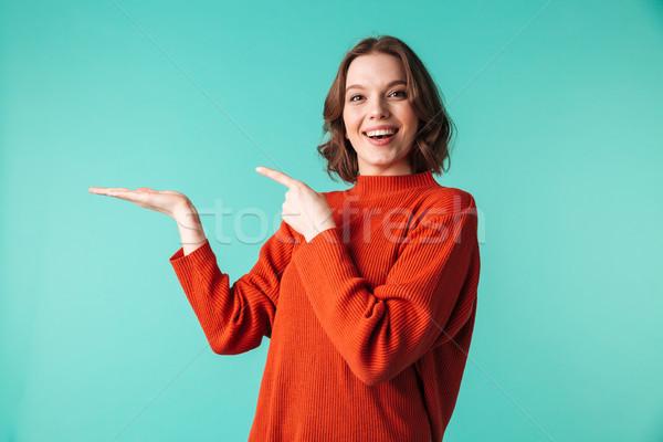 肖像 快樂 年輕女子 毛線衣 指向 手指 商業照片 © deandrobot