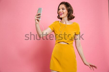 Portrait of a joyful young woman dressed in swimsuit Stock photo © deandrobot