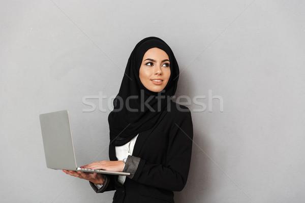 Portrait of muslim elegant woman 20s in black traditional clothi Stock photo © deandrobot