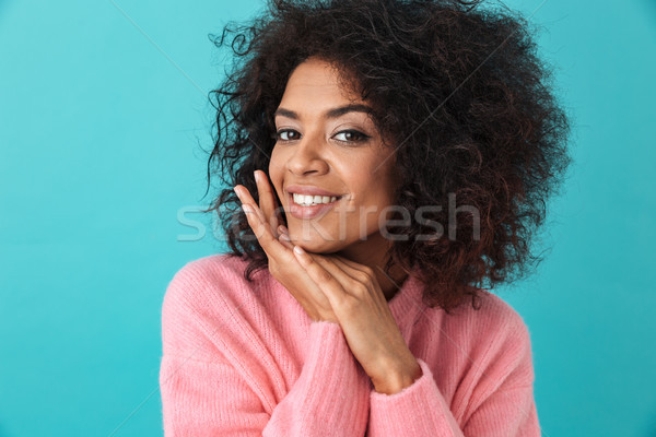 Multicolor image of pretty woman 20s with afro hairstyle smiling Stock photo © deandrobot