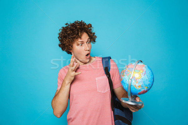 Portrait of caucasian genius guy with curly hair wearing backpac Stock photo © deandrobot