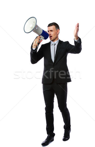 Full length portrait of businessman yelling through megaphone isolated on white background Stock photo © deandrobot