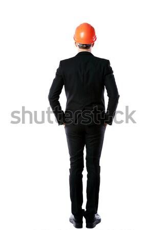 Arkadan görünüm portre işadamı turuncu kask ayakta Stok fotoğraf © deandrobot