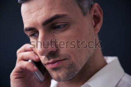 Pensive businessman talking on the phone Stock photo © deandrobot
