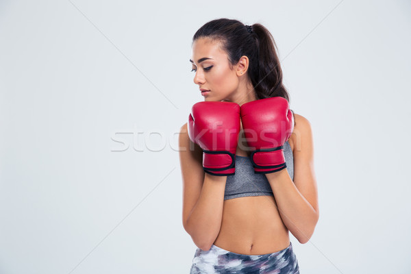 Sports woman standing in defence stance with boxing gloves Stock photo © deandrobot