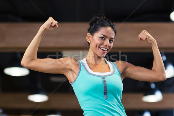 Sports woman showing her biceps  Stock photo © deandrobot
