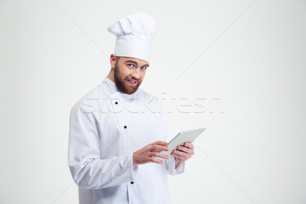 Smiling chef cook holding tablet computer Stock photo © deandrobot