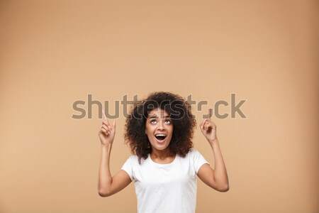 Crazy woman with hair up into air Stock photo © deandrobot