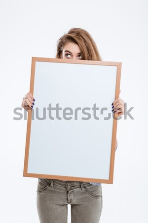 Woman peeping over blank board  Stock photo © deandrobot
