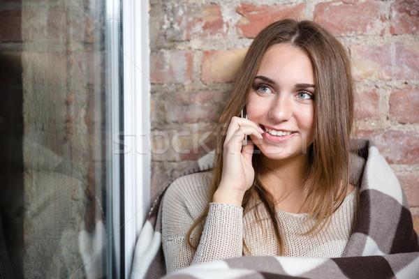 Nő meleg kockás beszél telefon mosolygó nő Stock fotó © deandrobot