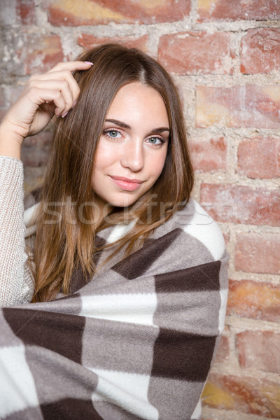 Happy woman in warm plaid Stock photo © deandrobot