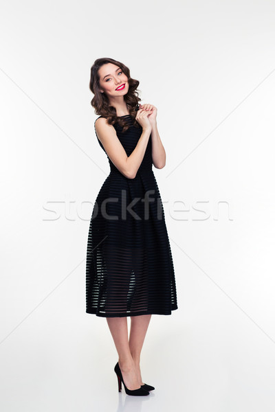 Full length of cheerful retro styled female in black dress  Stock photo © deandrobot