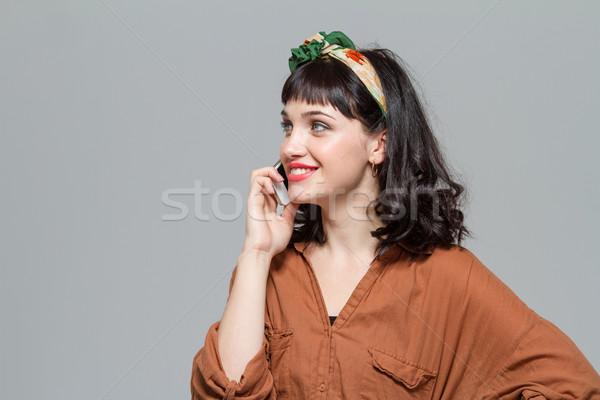 Contenuti sorridere cute parlando cellulare Foto d'archivio © deandrobot