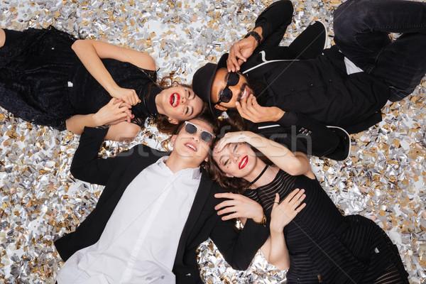 Joyeux jeunes souriant confettis haut Photo stock © deandrobot