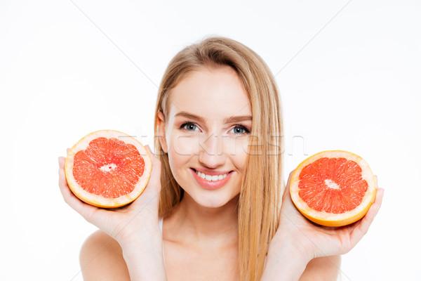 Happy woman holding grapefruit Stock photo © deandrobot