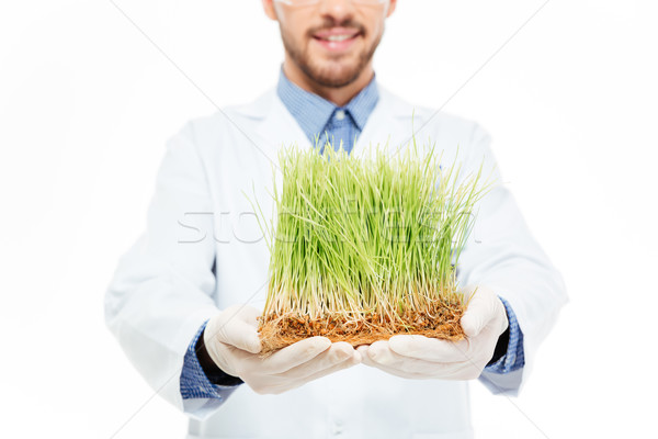 Male engineer showing a modified plants Stock photo © deandrobot