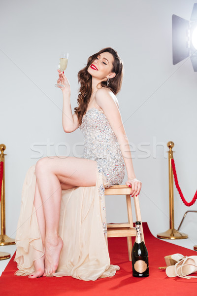 Femme verre champagne tapis rouge charmant Photo stock © deandrobot