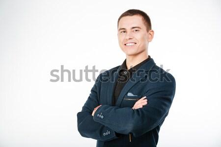 Wesoły biznesmen stałego broni fałdowy odizolowany Zdjęcia stock © deandrobot
