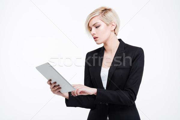 Beautiful businesswoman using tablet computer Stock photo © deandrobot