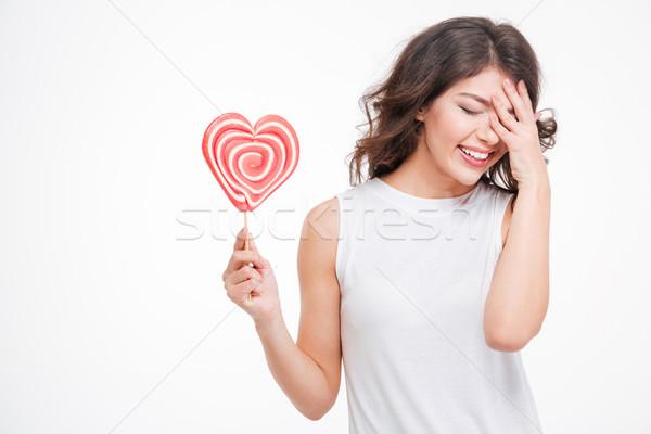 Risonho mulher pirulito retrato jovem Foto stock © deandrobot